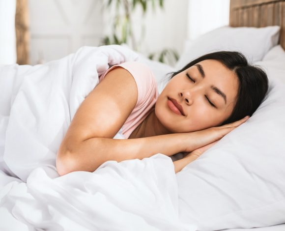 What Makes A Mattress Heavy Duty? Girl laying comfortably on a Heavy Duty Mattress.